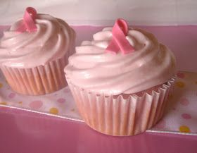 Pink strawberry cake filled with strawberry mascarpone, topped with strawberry cream cheese frosting and a pink gum paste ribbon October is...