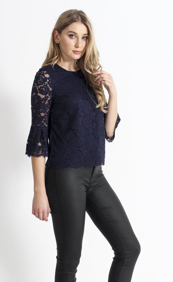 Lace Bell Sleeve Top | Bell sleeves are on trend this season, and the gorgeously detailed lace of this top showcases them perfectly. With a scallop edge at both the sleeves and hem, this piece will dress up any outfit for a sophisticated look.