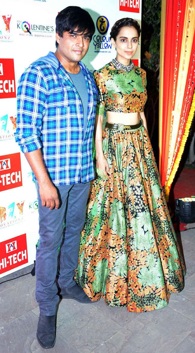 R Madhavan strikes a pose with Kangana Ranaut at the poster launch event of 'Tanu Weds Manu Returns'. #Bollywood #Fashion #Style #Beauty #Handsome