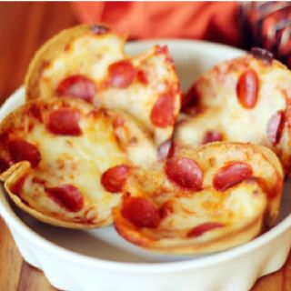 Yummy mini pizzas!!  Spray muffin tins with nonstick cooking spray. Cut soft tortilla shells with an empty can and place in muffin tin. Pour in pizza sauce, add some cheese and mini pepperonis if you want. Viola!