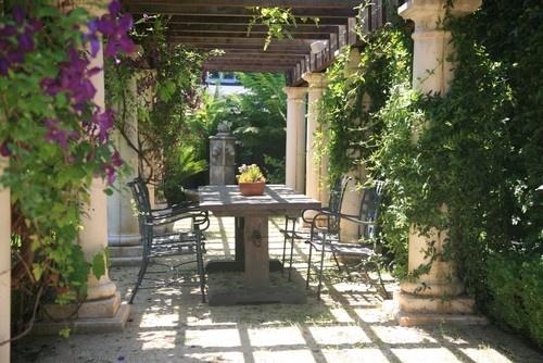 Clemitis and vinca vine coverd patio...