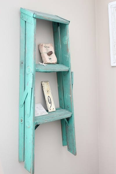 Ladder shelf. It's a ladder. Repurposed as a shelf. Clever idea & gotta love the Tiffany blue shabby chic paint!