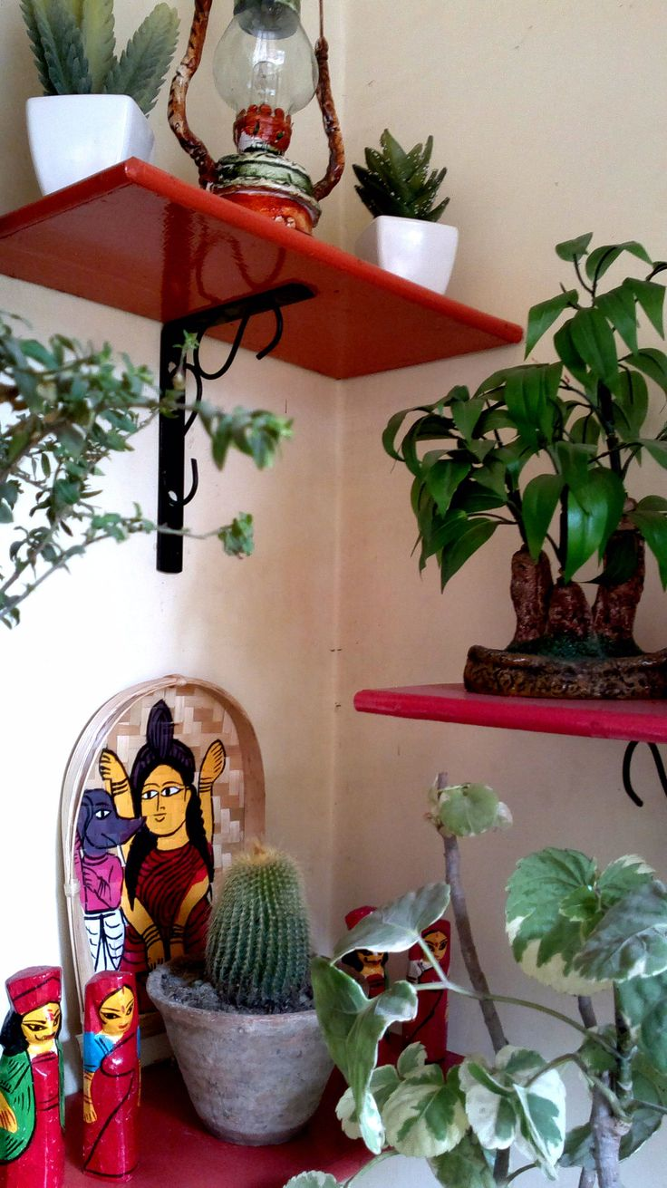 a corner in my small balcony...adorned with bamboo patachitra, wooden dolls,plants and a tiny lantern which i love very much !