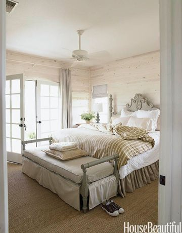 """""""The master bedroom has a wild sage color on the painted bench and again on the bed,"""" designer Ginger Barber says of this house in Round Top, Texas. """"I love it against the crisp white linen and whitewashed walls.""""   - HouseBeautiful.com"""