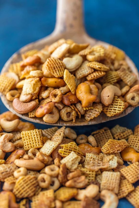 BEST EVER CHEX PARTY MIX is the ultimate holiday appetizer! Our family has this PERFECT cereal party mix in bulk every Christmas. SO ADDICTING! The Cookie Rookie