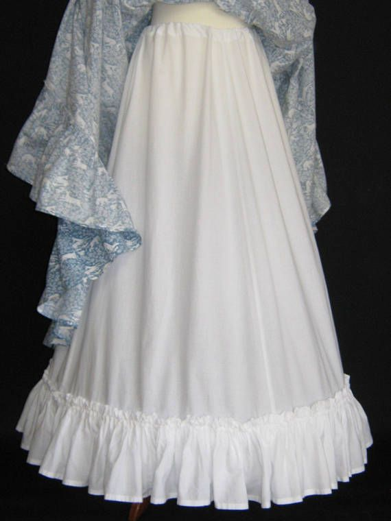 L A U R A A S H L E Y  I dont like ephemeral things, I like things that last forever  PETTICOAT IN PURE WHITE SOFT COTTON OF APPROX ANKLE/FULL- LENGTH WITH BROAD RUFFLE HEM AND INSIDE SLIT OPENINGS FOR THE REMOVABLE HOOP  A BEAUTIFUL AND VERSATILE ACCESSORY TO ENHANCE THE VOLUME OF
