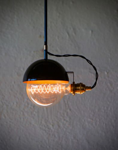 """I have to admit, I'm in love with these globe bulbs! Many of my designs actually start with the bulb and my desire to show it off."" The Black Ball pendant is no exception. Gloss black exterior, brass"