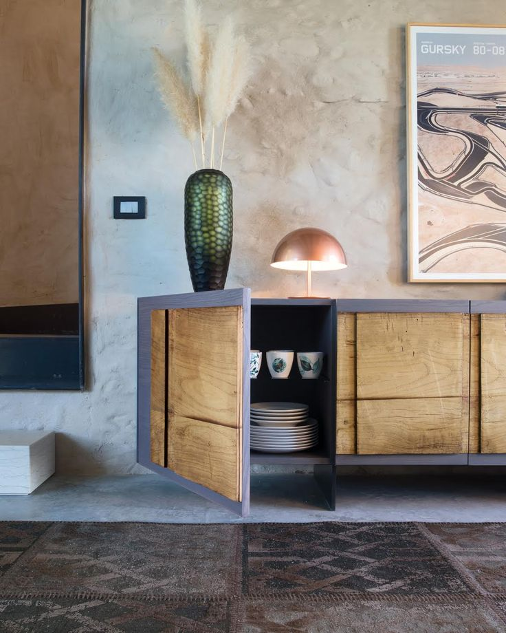 RETRO | An ancient door, to which new life has been given, is what forms the front side of the Rétro sideboard. The ash structure offers a variety of color options to make the furniture extremely versatile. #NatureDesign #madeinitaly