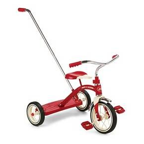 """The Radio Flyer® Classic Red Tricycle with Push Handle is great for going to parks or around the neighborhood. The removable 3-position adjustable handle helps guide your child's ride. This sturdy trike also features steel construction, durable spoked wheels, a 10"""" front wheel and real rubber tires. The controlled turning radius prevents tipping for safe and confident riding. This bright red tricycle is classically styled and includes chrome handlebars and fender...."""