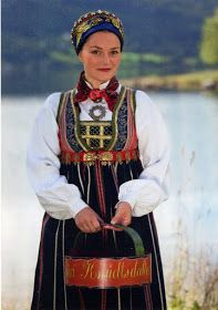 Upper Valdres Bunad, or Bringedukdrakt  This  has been established as the bunad for Upper Valdres, namely Vang and Slidre. The second term refers to the stomacher or plastron which is inserted into the bodice. This was typical for the first half of the 19th cent. The everyday costume is plain blue.