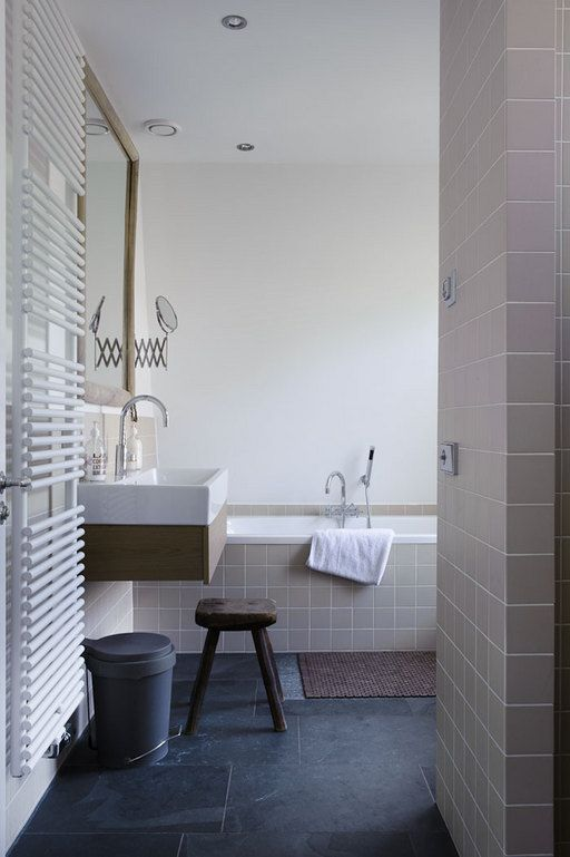 Brown, grey and white bathroom with bath, stool and washstand