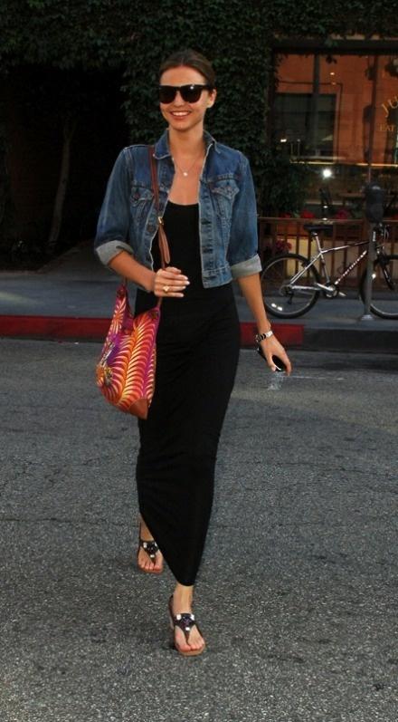 Miranda Kerr is black maxi dress and crop denim jacket