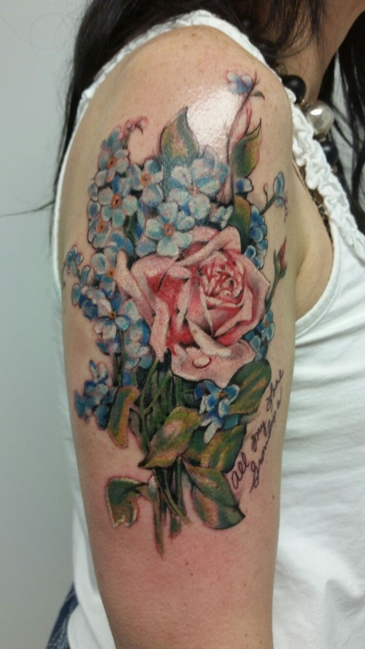 Antique flower tattoo