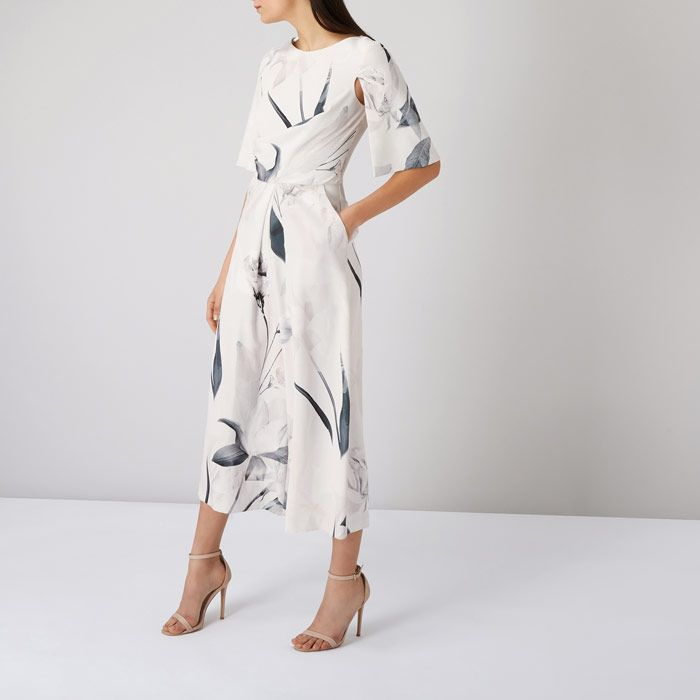 This Printed Savannah Jumpsuit from @Coast_Stores is an effortlessly cool addition to any wardrobe.with an abstract floral print, cape sleeves and culotte trousers😍
