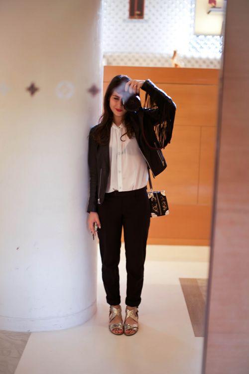 Black leather fringe jacket with sheer blouse