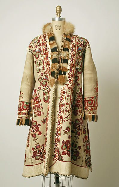 Coat Date: 1900 Culture: Romanian Medium: leather Dimensions: Length at CB: 40 1/4 in. (102.2 cm) Credit Line: Gift of Susan Kessel Kopp, 1995 Accession Number: 1995.452