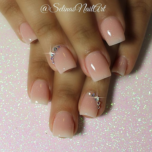 Short & sweet @inmnails pink acrylic nails with a dash of northern lights acrylic✨