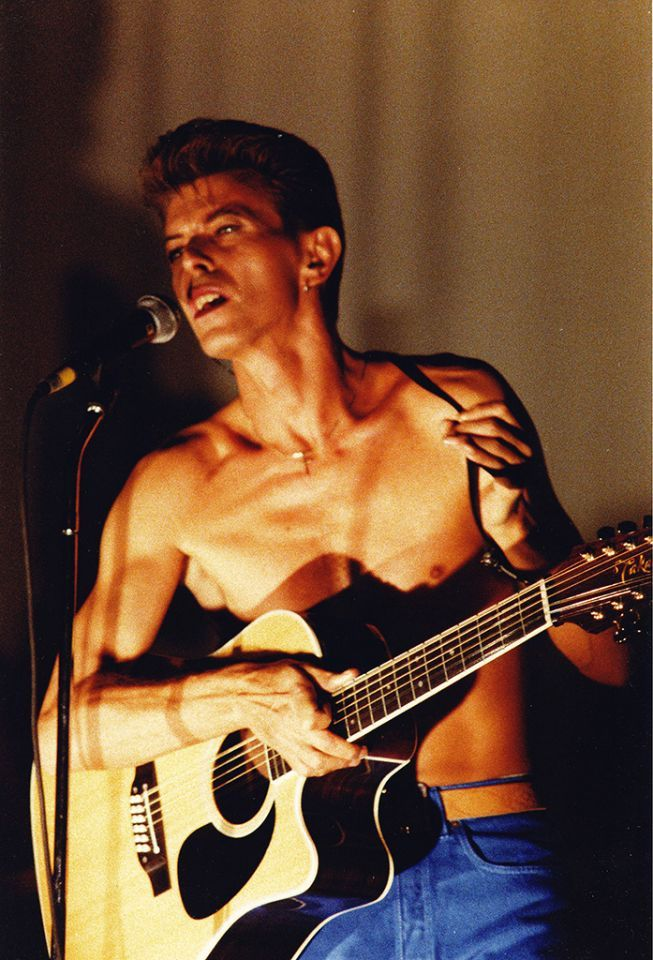 "RIP David Bowie (bio): In 1988, Bowie formed the supergroup Tin Machine with Reeves Gabrels, Tony Sales, and Hunt Sales; the band released two albums, ""Tin Machine"" and ""Tin Machine II."" Here, Bowie is pictured performing with the group at the concert to promote the latter album at the Brixton Academy in London on Nov. 11, 1991. (Photo: Redferns)"