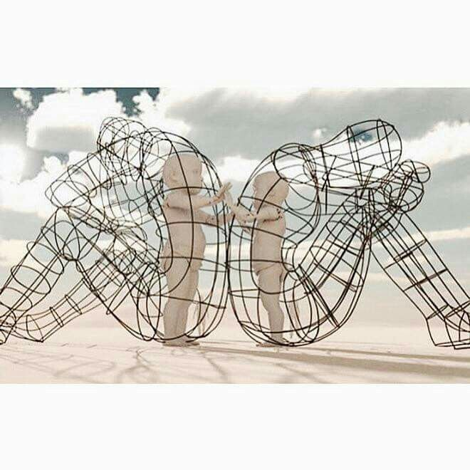 A sculpture of 2 adults fighting, backs to one another.....yet the inner child in them both just want to connect and love one another.