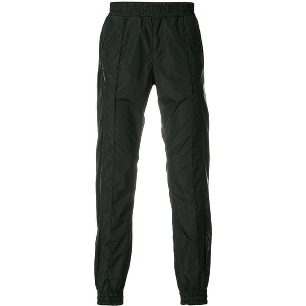 Versace contrast block tracksuit bottoms ($595) ❤ liked on Polyvore featuring men's fashion, men's clothing, black and versace mens clothing