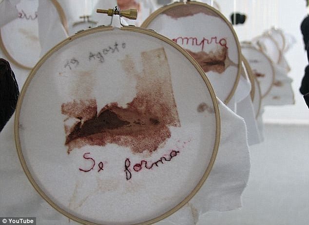 Woman who collected her menstrual blood on pieces of cloth for five years displays stained fabric in 'intimate' art exhibition