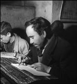 David Seymour ITALY. Calabria. Town of Rogiano Gravina. 1950.  The battle against illiteracy. Peasant during a writing class.