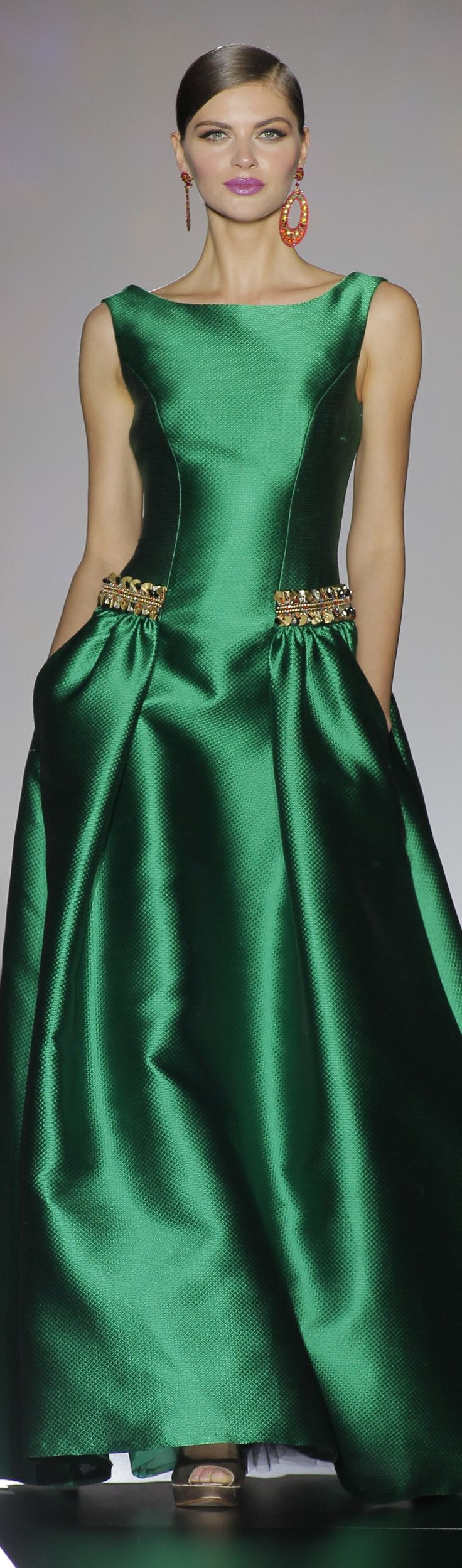 Peeptoe plats, shimmering satin green tank maxi dress w/ golden hip ornamentations, magenta smile, large orange hoop earrings, dark hair gelled back ~ Patricia Avendano