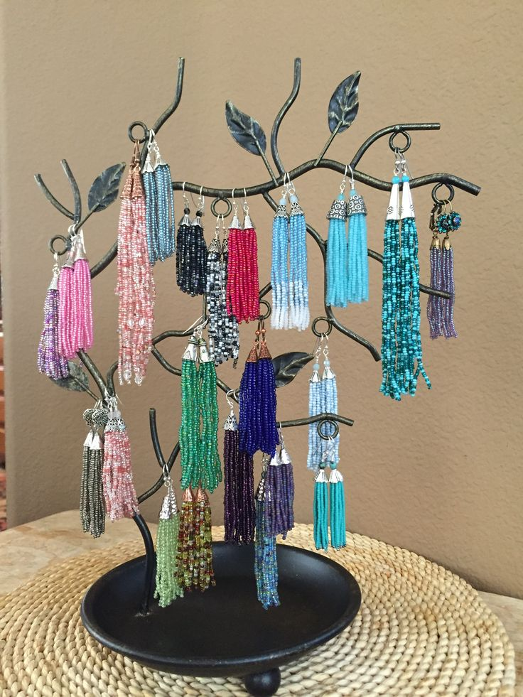 """These tassels show an """"ombre"""" effect as the beads graduate from solid sky blue to a mix of blue and white to milky white. The tassels drop 3 inches from the bottom of the sterling silver ear wiere."""