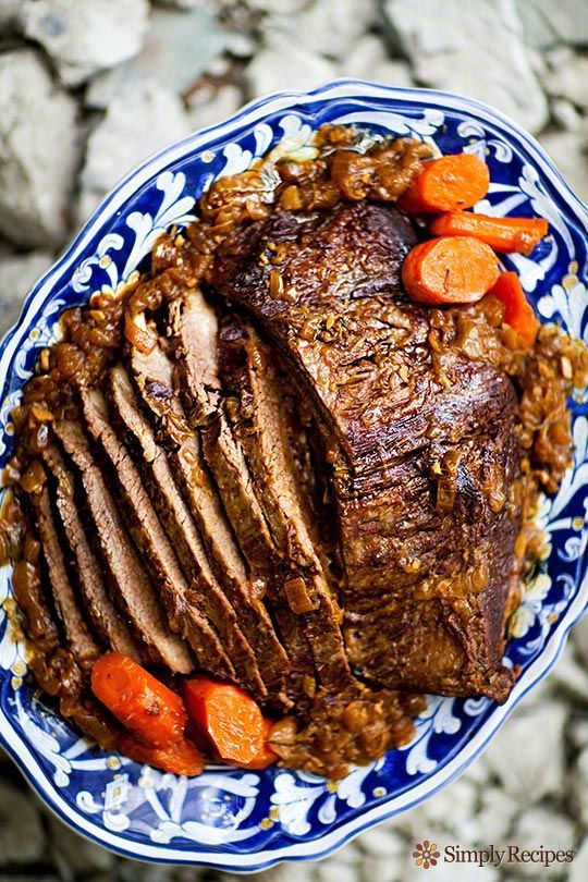 Beef brisket pot roast, slowly cooked with onions, garlics, herbs, and carrots. ~ SimplyRecipes.com