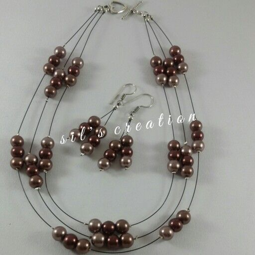 floating necklace with earings. ..