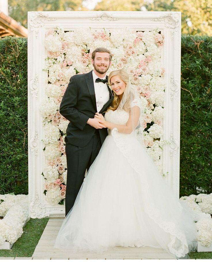 Amazing DIY ceremony backdrop with a vintage frame and tons of flowers! | http://www.weddingpartyapp.com/blog/2014/09/23/three-ways-fabulous-wedding-flower-decor-big-day/