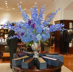 Tall Arrangement # 1  blue delphinium and blue hydrangea. Would not be quite this large, but still very large and would be in a clear glass vase, same shape.