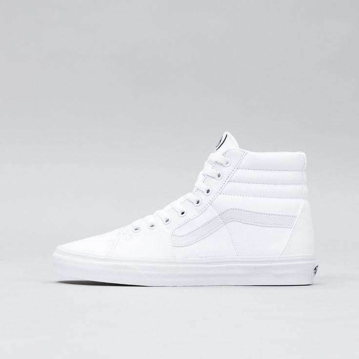 All white lace-up high top originally inspired by the classic Old Skool. Features a durable canvas and suede upper, a supportive and padded ankle, and Vans vulcanized signature waffle outsole. • Style