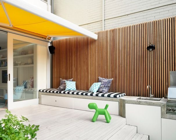 Vertical fence battens - 42mm x 19mm spotted gum with a 10mm gap between the boards