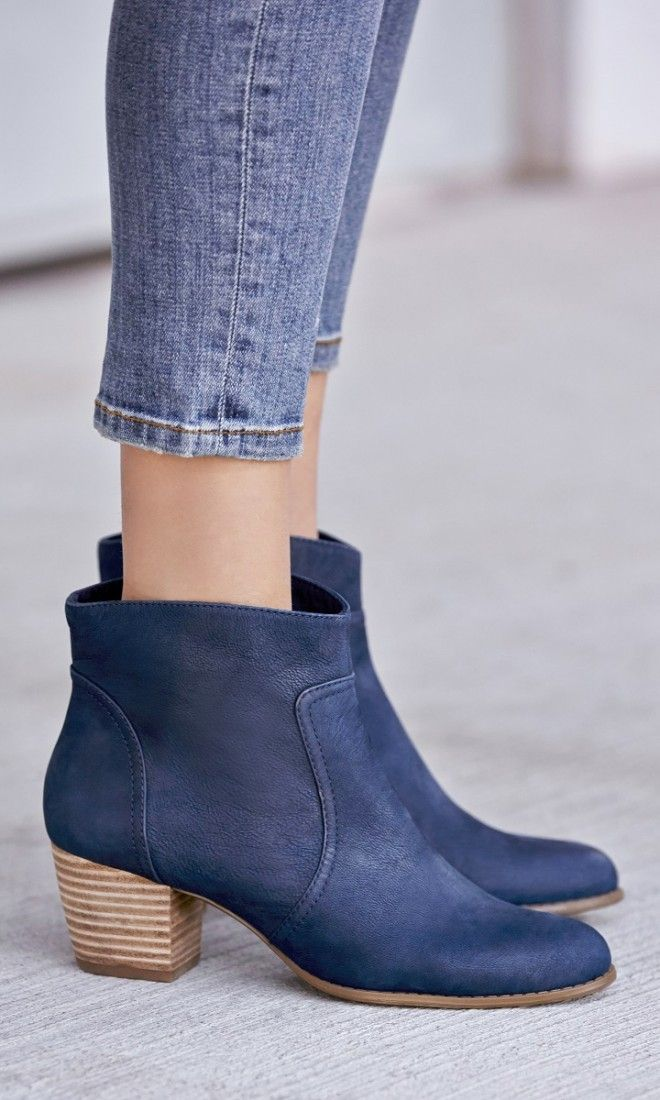 Versatile leather ankle bootie with a rounded toe and walkable stacked heel