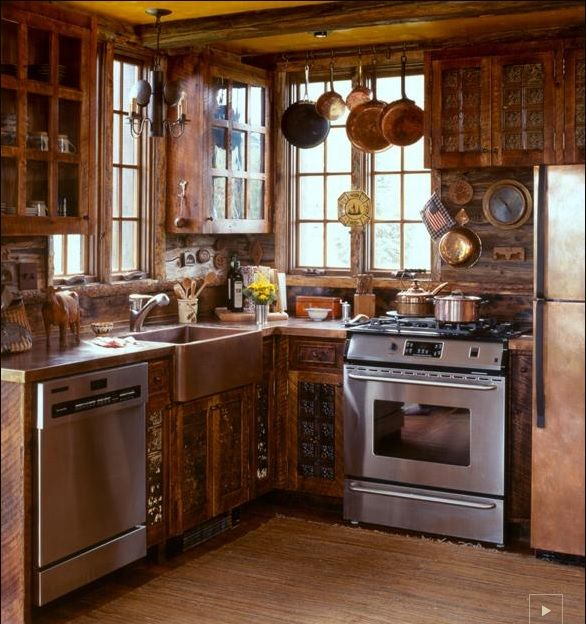 tiny kitchen ideas... love the pot hanger above a tall window.... and the fridge color.... and the wood accenting.. this is from an 1912 cabin!!! http://ctmarchitects.com/project/swedish-guest-cabin
