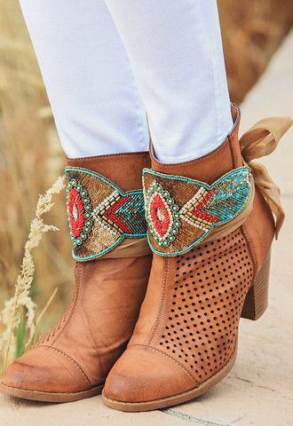 Wow! Need we say more? The Tucson hat wrap is truly eye-catching! The intricate hand beaded jewels are full of color and southwestern flare! You could also wear this amazing accessory wrapped around a