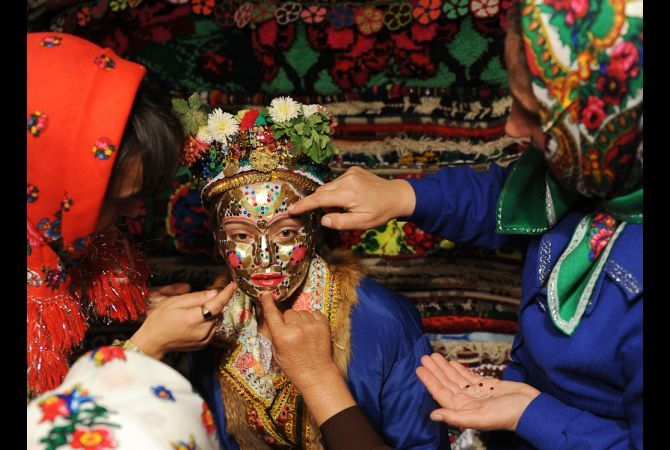A Bulgarian Muslim bride from the Pomak ethnic group, attended to during her wedding ceremony in the village of Draginovo, 100 kms southeast of Sofia. October 30, 2009.