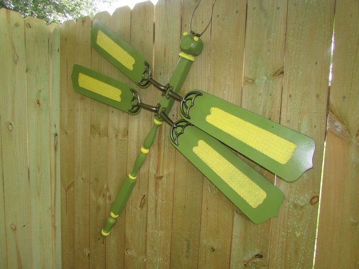 Supplies Needed:Spindle  Top Fence Post4 Ceiling Fan BladesItem For The EyesItem For The Antenna finial for the tailPaint After seeing a picture of dragonflies…