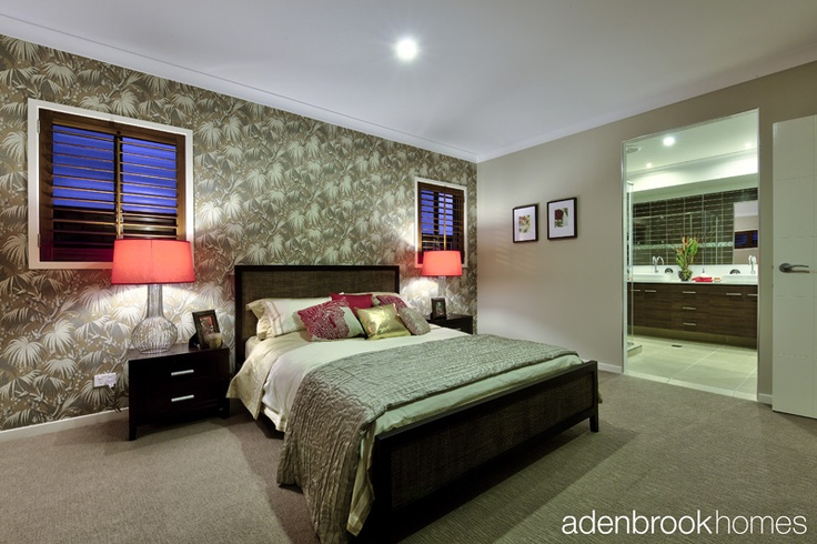 Master suite with feature wallpaper.