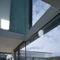 The upper internal courtyard further illuminates the kitchen and existing house