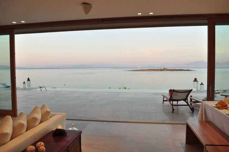 Villa Irina lies itself on a perfect spot in Vagia Mesagros, right on the coast overlooking a small islet with a picturesque little church and the coast of Attica. Within few minutes you can get yourself wet to the crystal clear waters of a lovely isolated bay just 30m away from your doorway. #vacationrentals #villas