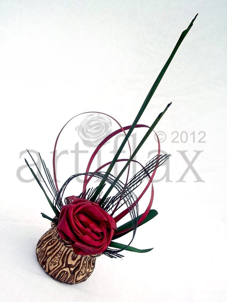 Flax flowers by Artiflax arranged in a ponga vase by Fernwood NZ