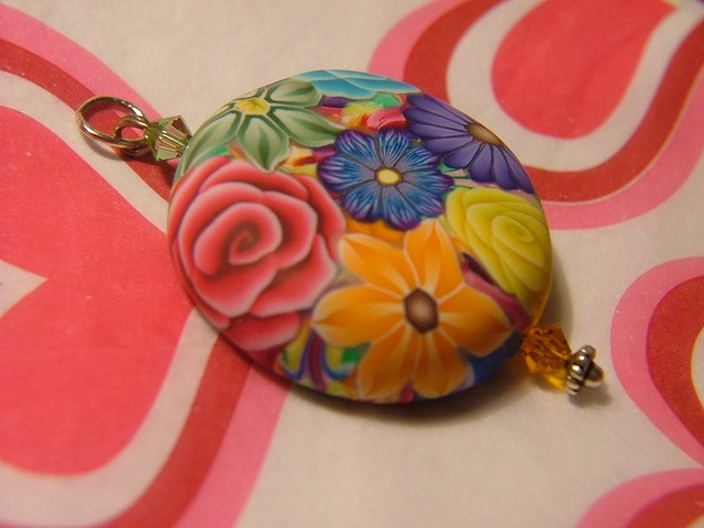 Polymer Clay Covered Bottle Cap Pendant by polymerclaycreations, via Flickr