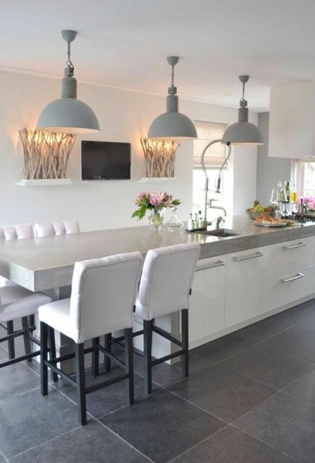 concrete floor, white units, granite worktop