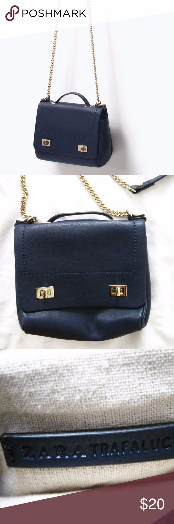 Zara Navy Mini Messenger Bag With Chain A navy mini messenger bag featuring a single handle and a gold hardware and chain. Inner lining. Great condition-minor scratch above the left closure (see image 4), other than that no scratches or any other flaws on the bag. Smoke/pet-free home. Feel free to ask questions! Measurements: 8 inches in height. 6 inches in width. Lining fabric content: 50 cotton. 30% linen. 20% polyester. Zara Bags Crossbody Bags