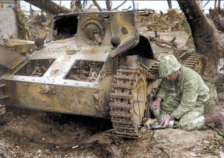 US Marine Combat Photographer S/Sgt. Norman Hatch with the 2nd US Marine Division, gives a drink of water to a stray kitten found hiding beneath a knocked out Japanese Type 95 Ha-Go light tank, at Tarawa Atoll in the Pacific. November 24 1943. The tank is missing it's turret which housed the 37mm Type 98 Anti -tank gun. On the eve of the Battle of Tarawa, Norman was in a small boat, bobbing in the waves toward the tiny Pacific Ocean atoll, together with Marines of the 2nd Marine Division…