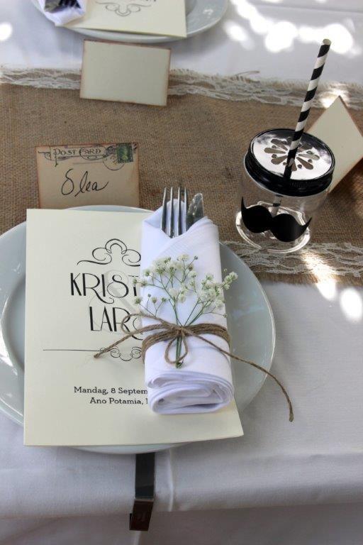 Wedding table settings with menu and burlap table runner and string #greekislandwedding #naxosweddings