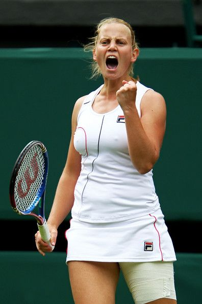 Jelena Dokic of Australia reacts to a play during her first round match against Francesca Schiavone of Italy on Day One of the Wimbledon Lawn Tennis Championships at the All England Lawn Tennis and Croquet Club on June 20, 2011 in London, England. (June 19, 2011 - Source: Clive Brunskill/Getty Images Europe)