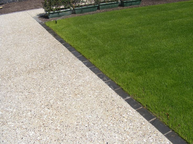 exposed aggregate concrete with shell nz - stephensons